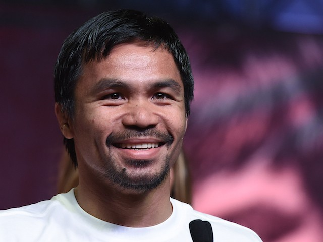 WBO welterweight champion Manny Pacquiao smiles during a fan rally at the Mandalay Bay Convention Center on April 28, 2015