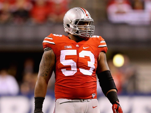 Defensive lineman Michael Bennett wears #53 to honor late teammate Kosta Karageorge of the Ohio State Buckeyes during the Big Ten Championship against the Wisconsin Badgers at Lucas Oil Stadium on December 6, 2014