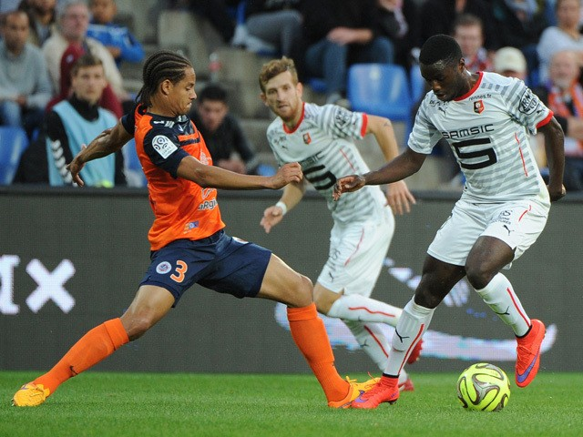 Montpellier's defender Daniel Congre (L) vies for the ball with Rennes's forward Paul Georges Ntep (R) during the French L1 football match between Montpellier and Rennes on May 2, 2015