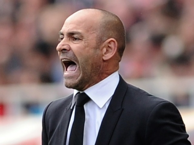 Rayo Vallecano's coach Paco Jemez reacts during the Spanish league football match Sevilla FC vs Rayo Vallecano de Madrid at the Ramon Sanchez Pizjuan stadium in Sevilla on April 26, 2015