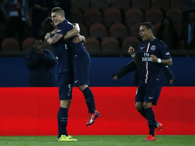 Paris Saint-Germain's Italian midfielder Marco Verratti celebrates with Dutch defender Gregory van der Wiel and Brazilian defender Maxwell after scoring a goal during the French L1 football match between Paris Saint-Germain (PSG) and Metz at the Parc des