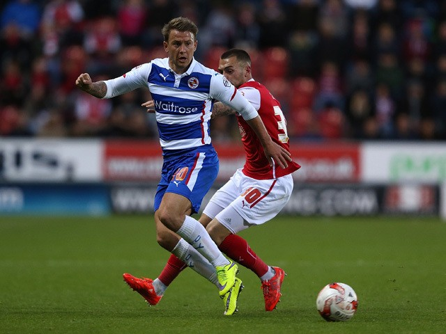 Simon Cox of Reading controls the ball from Jack Hunt of Rotherham during the Sky Bet Championship match between Rotherham United and Reading at The New York Stadium on April 28, 2015