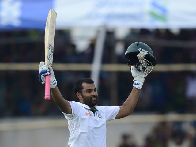 Bangladesh cricketer Tamim Iqbal reacts after scoring a century (100 runs) during the fourth day of the first cricket Test match between Bangladesh and Pakistan at The Sheikh Abu Naser Stadium in Khulna on May 1, 2015