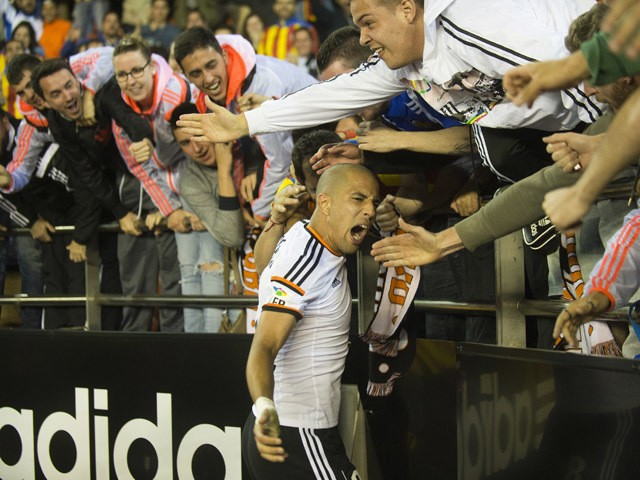 Valencia's French midfielder Sofiane Feghouli celebrates his goal with fans during the Spanish league football match Valencia CF vs Granada FC at the Mestalla stadium in Valencia on April 27, 2015