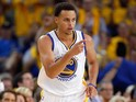 Stephen Curry #30 of the Golden State Warriors reacts after he made a three-point basket against the Memphis Grizzlies during Game One of the Western Conference Semifinals during the NBA Playoffs on May 3, 2015