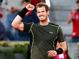 Andy Murray of Great Britain celebrates defeating Milos Raonic of Canada in the quarter final during day seven of the Mutua Madrid Open tennis tournament at the Caja Magica on May 8, 2015