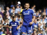Chelsea captain John Terry celebrates after giving his side the lead against Liverpool at Stamford Bridge on May 10,2015