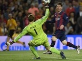 Barcelona's Argentinian forward Lionel Messi (R) scores a goal during the UEFA Champions League football match FC Barcelona vs FC Bayern Muenchen at the Camp Nou stadium in Barcelona on May 6, 2015