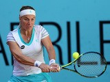 Svetlana Kuznetsova of Russia plays a backhand against Lucie Safarova of the Czech Republic in their quarter final round match during day six of the Mutua Madrid Open tennis tournament at the Caja Magica on May 7, 2015