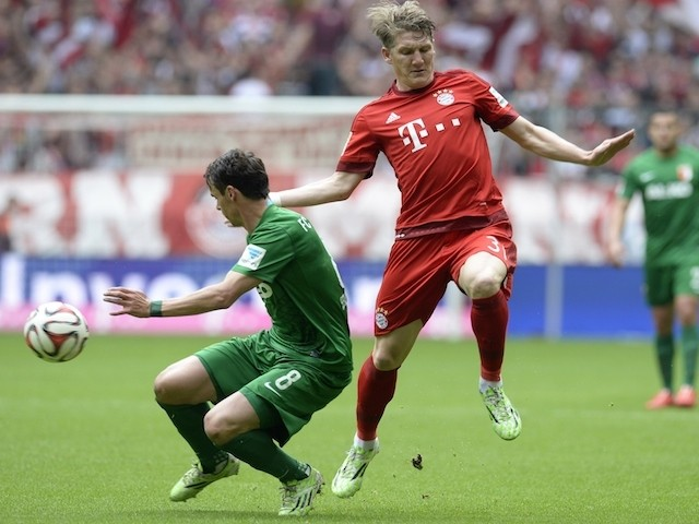 Bayern Munich's midfielder Bastian Schweinsteiger (R) and Augsburg's midfielder Markus Feulner (L) vie for the ball during the German first division Bundesliga football match between FC Bayern Munich and FC Augsburg in Munich, southern Germany, on May 9,