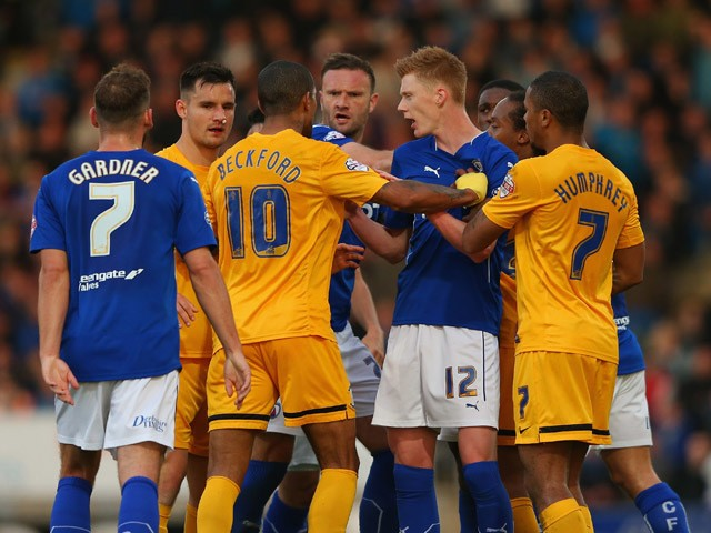 Tempers flare between the players of Chesterfield and Preston North End during the Sky Bet League One Playoff Semi-Final, first leg match between Chesterfield and Preston North End at the Proact Stadium on May 7, 2015