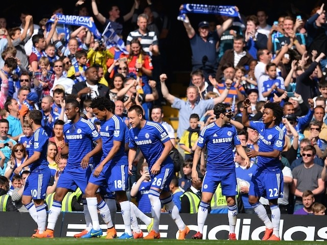 Chelsea players and fans celebrate the opening goal scored by Chelsea's English defender John Terry (C) during the English Premier League football match between Chelsea and Liverpool at Stamford Bridge in London on May 10, 2015