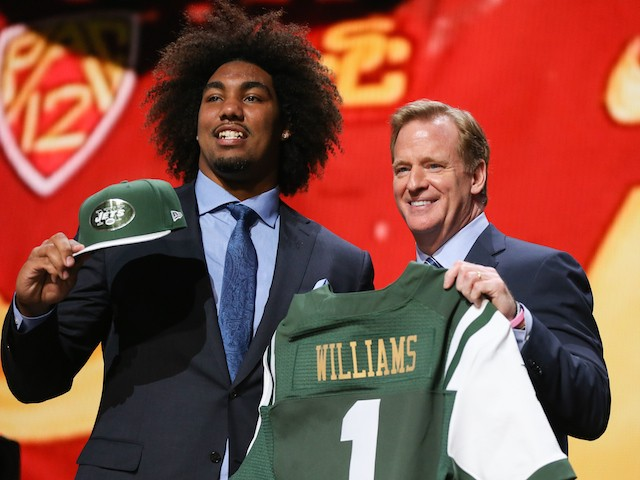 Leonard Williams of the USC Trojans holds up a jersey with NFL Commissioner Roger Goodell after being chosen #6 overall by the New York Jets during the first round of the 2015 NFL Draft at the Auditorium Theatre of Roosevelt University on April 30, 2015