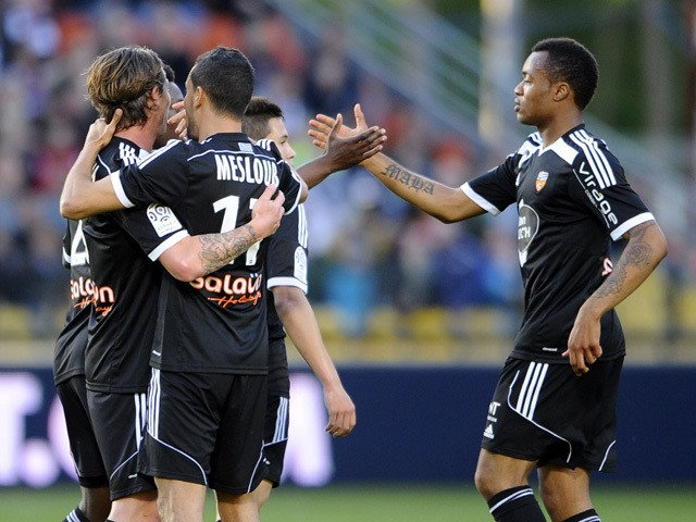 Lorient's players celebrate after scoring against Metz during the French L1 football match between Metz and Lorient at Saint Symphorien stadium in Longeville-Les-Metz, eastern France, on May 9, 2015