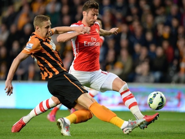 Hull defender Michael Dawson challenges Arsenal's Olivier Giroud during the Premier League match on May 4, 2015
