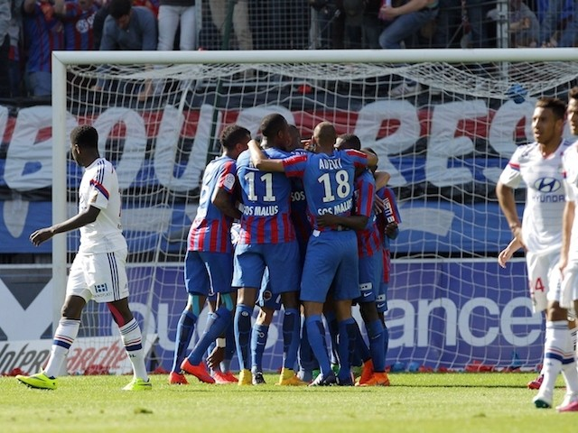 Caen players celebrates after French forward Nicolas Benezet scored during the French L1 football match between Caen and Lyon at the Michel d'Ornano stadium, in Caen, northwestern France on May 9, 2015
