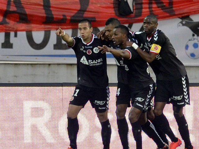 Reim's players celebrates after scoring a goal during the French L1 football match between Evian and Reims on May 9, 2015