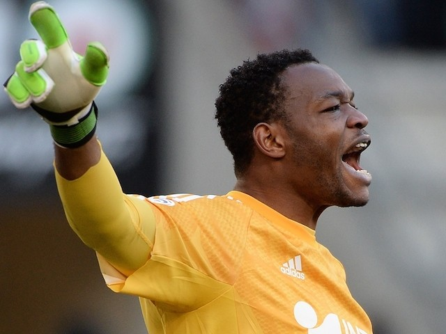 French goalkeeper Steve Mandanda reacts during the French L1 football match between Rennes (SRFC) and Marseille (OM) on February 7, 2015