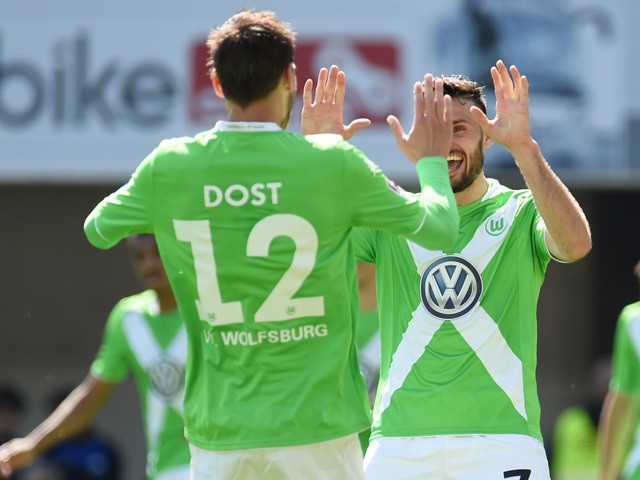 Wolfsburg's midfielder Daniel Caligiuri and Wolfsburg's Dutch striker Bas Dost celebrate during the German first division Bundesliga football match of SC Paderborn 07 vs VfL Wolfsburg in Paderborn, western Germany on May 10, 2015