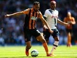 Danny Rose of Spurs closes down Ahmed Elmohamady of Hull City during the Barclays Premier League match between Tottenham Hotspur and Hull City at White Hart Lane on May 16, 2015