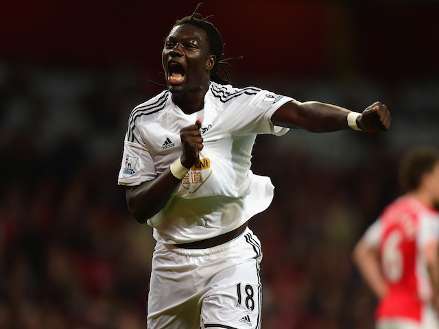 Bafetibis Gomis of Swansea City celebrates scoring the opening goal during the Barclays Premier League match between Arsenal and Swansea City at Emirates Stadium on May 11, 2015