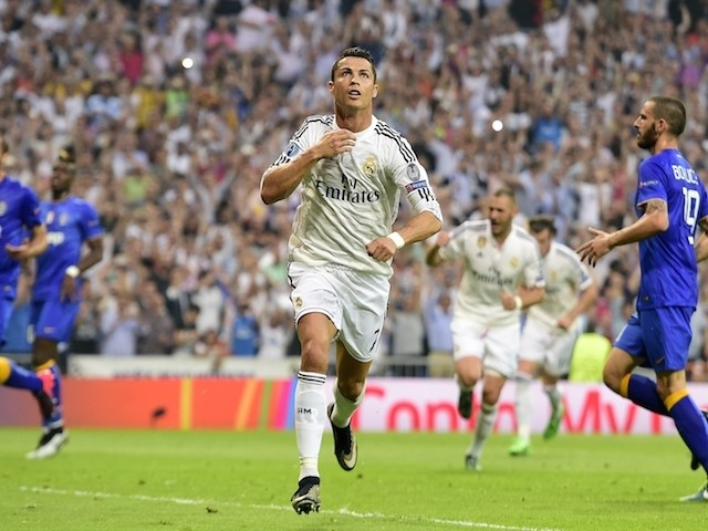 Portuguese forward Cristiano Ronaldo celebrates after scoring during the UEFA Champions League semi-final second leg football match Real Madrid FC vs Juventus at the Santiago Bernabeu stadium in Madrid on May 13, 2015