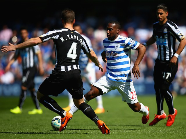 David Hoilett of QPR and Ryan Taylor of Newcastle United compete for the ball during the Barclays Premier League match between Queens Park Rangers and Newcastle United at Loftus Road on May 16, 2015