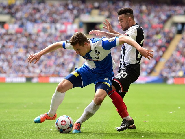 Tom Lockyer of Bristol Rovers holds off Nathan Arnold of Grimsby Town during the Vanarama Conference Playoff Final match between Grimsby Town and Bristol Rovers at Wembley Stadium on May 17, 2015