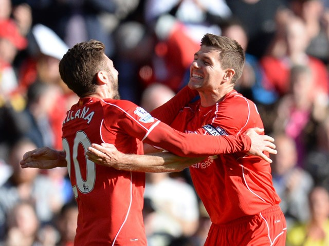 Liverpool's English midfielder Adam Lallana celebrates with Liverpool's English midfielder Steven Gerrard (R) after scoring the opening goal during the English Premier League football match between Liverpool and Crystal Palace at the Anfield stadium in Li