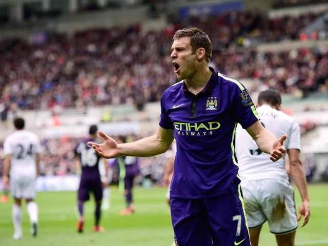 James Milner of Manchester City celebrates after scoring his team's second goal during the Barclays Premier League match between Swansea and Manchester City at the Liberty Stadium on May 17, 2015