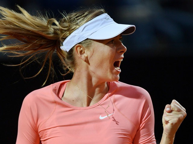 Maria Sharapova of Russia reacts during her match against Victoria Azarenka of Belarus at the WTA Rome Open tennis tournament at the Foro Italico in Rome on May 15, 2015