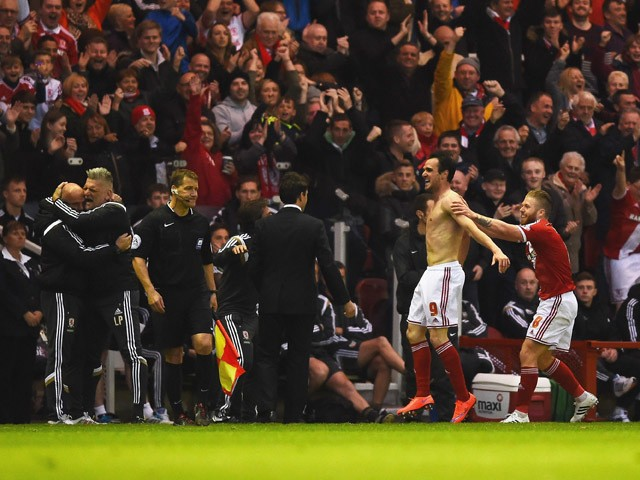 Enrique Garcia Kike of Middlesbrough (9) celebrates with the team bench as he scores their second goal during the Sky Bet Championship Playoff semi final second leg match between Middlesbrough and Brentford at the Riverside Stadium on May 15, 2015