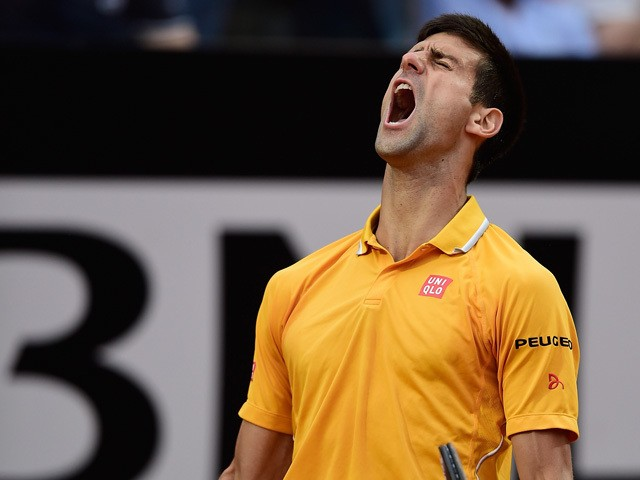 Novak Djokovic of Serbia celebrates wildly after breaking serve during his Quarter Final match against Kei Nishikori of Japan on Day Six of The Internazionali BNL d'Italia 2015 at the Foro Italico on May 15, 2015