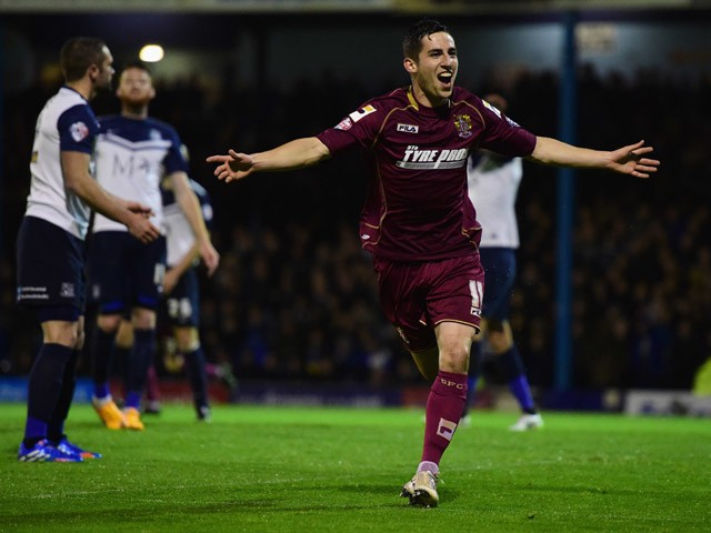 Tom Pett of Stevenage celebrates as he scores their first goal during the Sky Bet League Two Playoff semi final match between Southend United and Stevenage at Roots Hall on May 14, 2015