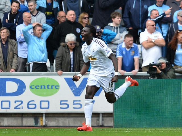Swansea City's French striker Bafetimbi Gomis celebrates scoring an equalising goal to level the score 2-2 during the English Premier League football match between Swansea City and Manchester City at The Liberty Stadium in Swansea, south Wales on May 17,