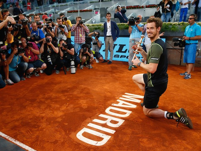 Andy Murray poses with the trophy after beating Rafael Nadal to win the Mutua Madrid Open on May 10, 2015