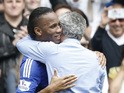 Chelsea's Portuguese manager Jose Mourinho hugs Chelsea's Ivorian striker Didier Drogba before the English Premier League football match between Chelsea and Sunderland at Stamford Bridge in London on May 24, 2015