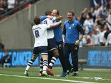 Jermaine Beckford of Preston North End celebrates with manager Simon Grayson after scoring during the League One play-off final between Preston North End and Swindon Town at Wembley Stadium on May 24, 2015