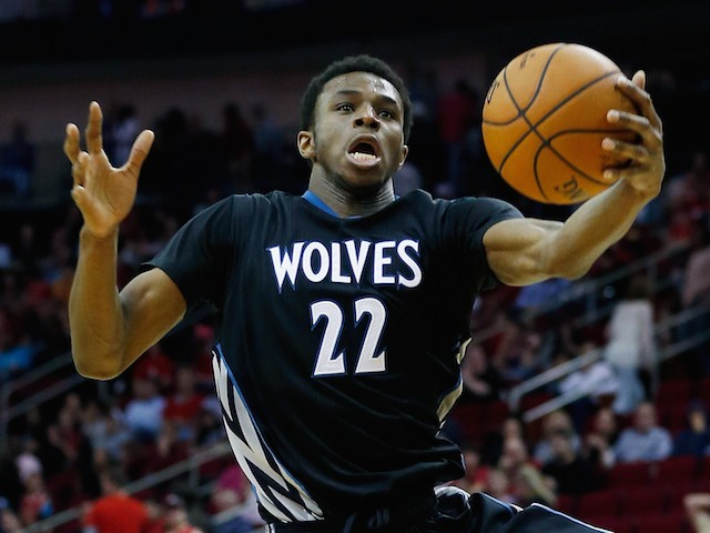 Andrew Wiggins #22 of the Minnesota Timberwolves leaps for the basketball during their game against the Houston Rockets at the Toyota Center on March 27, 2015