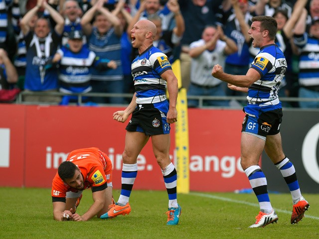 Bath players Peter Stringer and George Ford celebrate after Stringer had scored as Tommy Bell of the Tigers looks on during the Aviva Premiership semi final match between Bath Rugby and Leicester Tigers at Recreation Ground on May 23, 2015