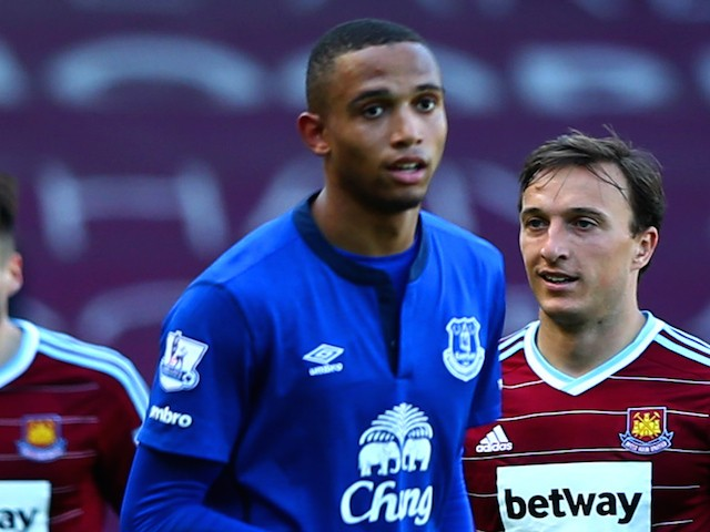 Brendan Galloway of Everton is shown a yellow card by referee Kevin Friend during the Barclays Premier League match between West Ham United and Everton at Boleyn Ground on May 16, 2015