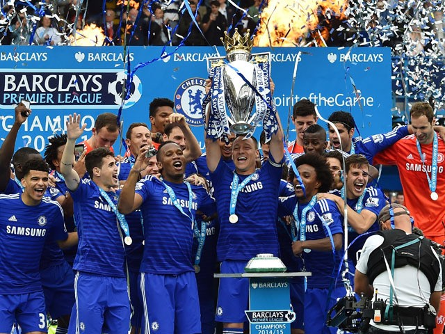 Chelsea's English defender John Terry holds up the trophy during the presentation of the Premier League trophy after the English Premier League football match between Chelsea and Sunderland at Stamford Bridge in London on May 24, 2015