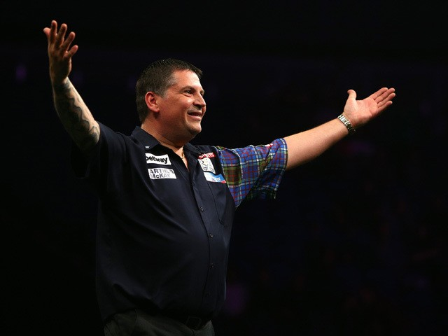 Gary Anderson of Scotland celebrates winning his semi-final match against Dave Chisnall of England during the Betway Premier League at The 02 Arena on May 21, 2015