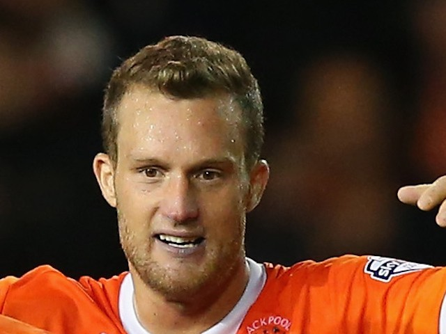 Jeffrey Rentmeister celebrates after victory over Cardiff City in the Sky Bet Championship match between Blackpool and Cardiff City at Bloomfield Road on October 3, 2014