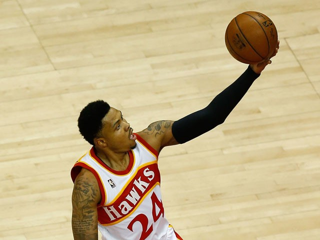 Guard Kent Bazemore #24 of the Atlanta Hawks shoots a layup in Game Two of the Eastern Conference Finals against the Cleveland Cavaliers during the 2015 NBA Playoffs at Philips Arena on May 22, 2015