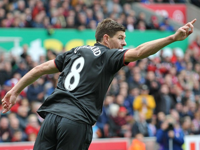 Liverpool's English midfielder Steven Gerrard celebrates scoring their first goal during the English Premier League football match between Stoke City and Liverpool at the Britannia Stadium in Stoke-on-Trent, central England on May 24, 2015