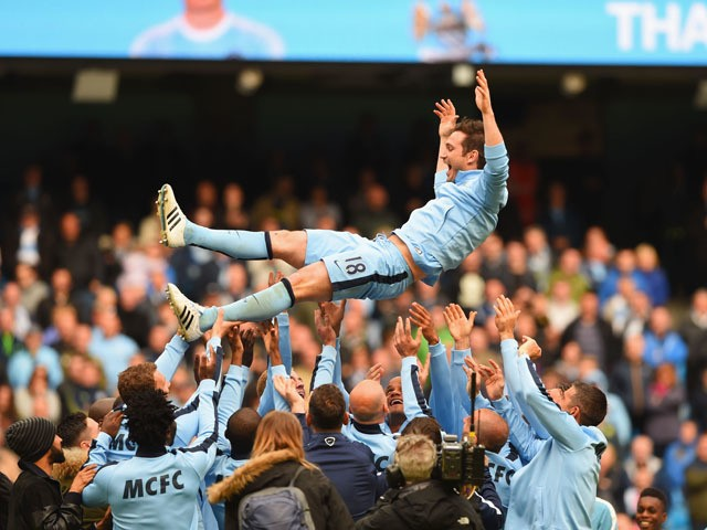 Frank Lampard of Manchester City is thrown into the air by his team mates after the Barclays Premier League match between Manchester City and Southampton at Etihad Stadium on May 24, 2015