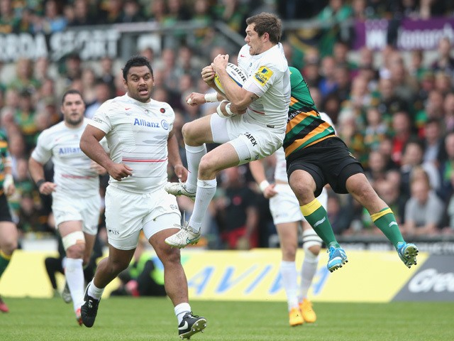 Alex Goode of Saracens catches the ball as George Pisi challenges during the Aviva Premiership play off semi final match between Northampton Saints and Saracens at Franklin's Gardens on May 23, 2015