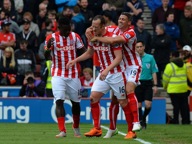 Charlie Adam of Stoke City celebrates scoring his team's fourth goal with his team mates Mame Biram Diouf and Jonathan Walters during the Barclays Premier League match between Stoke City and Liverpool at Britannia Stadium on May 24, 2015