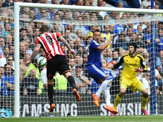 Sunderland's English-born Scottish striker Steven Fletcher scores during the English Premier League football match between Chelsea and Sunderland at Stamford Bridge in London on May 24, 2015